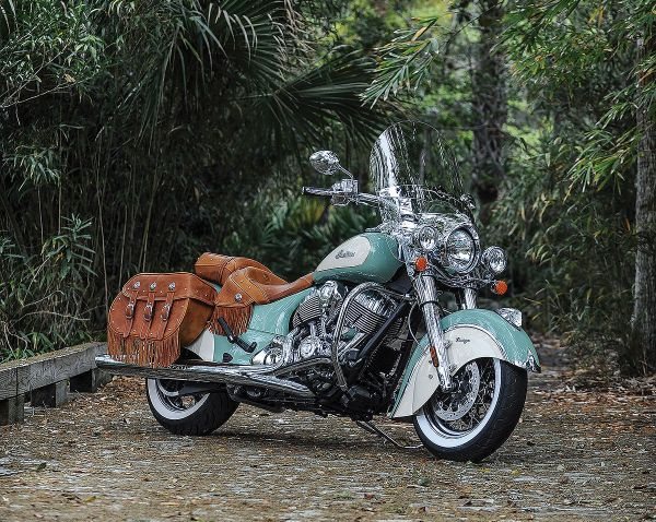 Americana Is Here to Stay - Indian Motorcycles is killing the vintage Easy Rider game: The Scout is the best looking roadster out there and the Chief Vintage comes in two-tone cream-and-teal and has standard fringed-leather saddlebags. If you're going to cruise, why not have some fringe flying in the background?