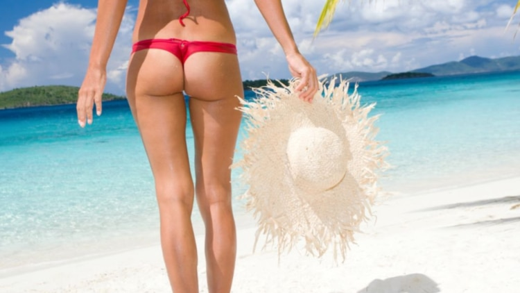 Woman on exotic tropical beach