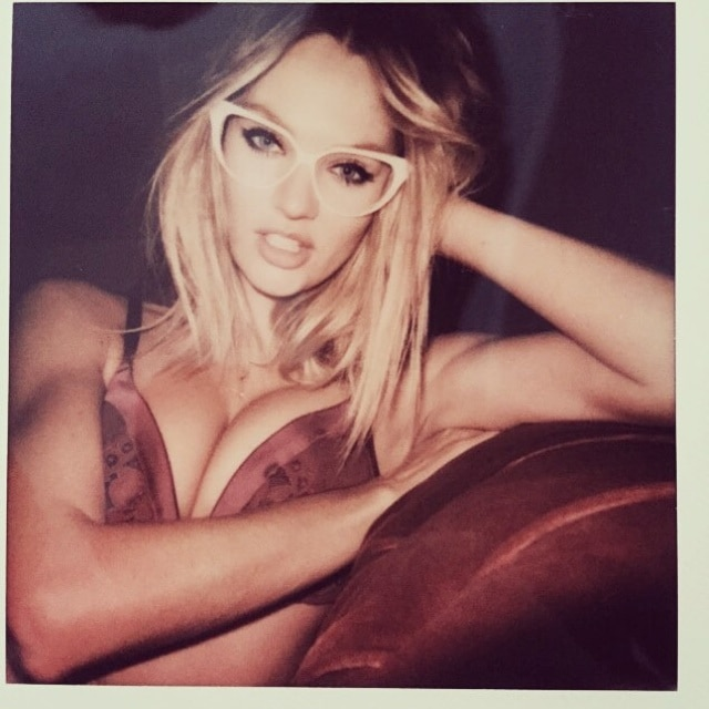 Candice Swanepoel sports cleavage—oh, and glasses