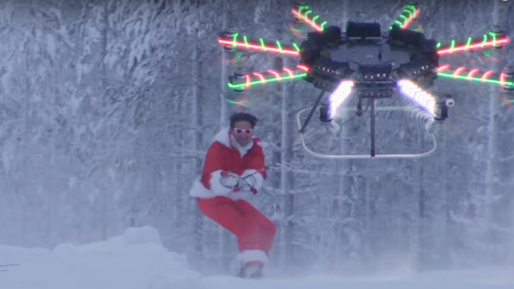 The video starts with the drone towing Neistat on a snowboard