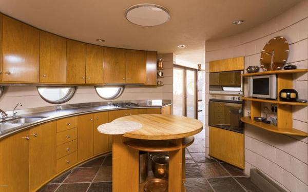 The kitchen's curvy countertops and plentiful storage