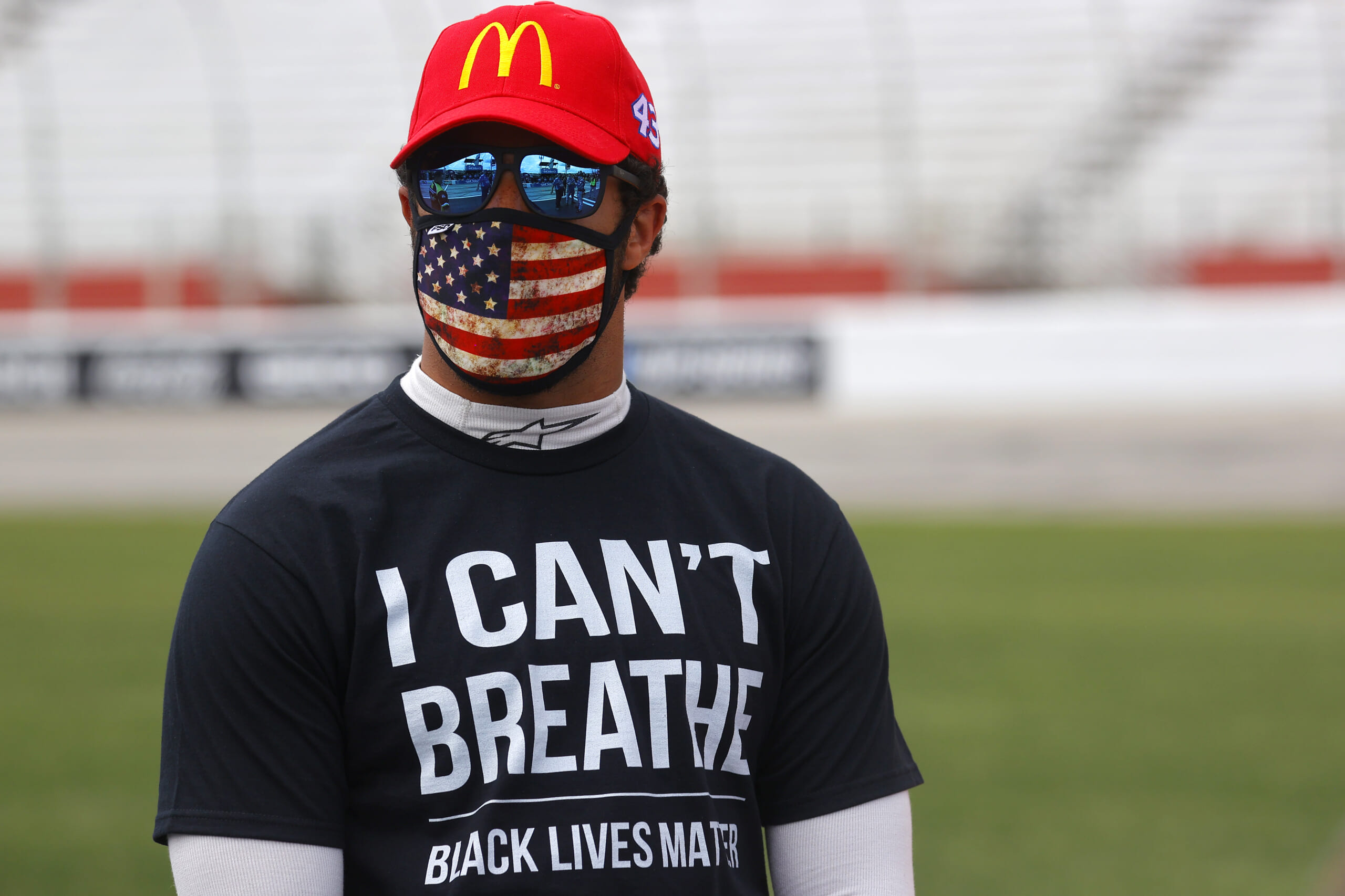 Bubba Wallace, driver of the #43 McDonald's Chevrolet, wears a