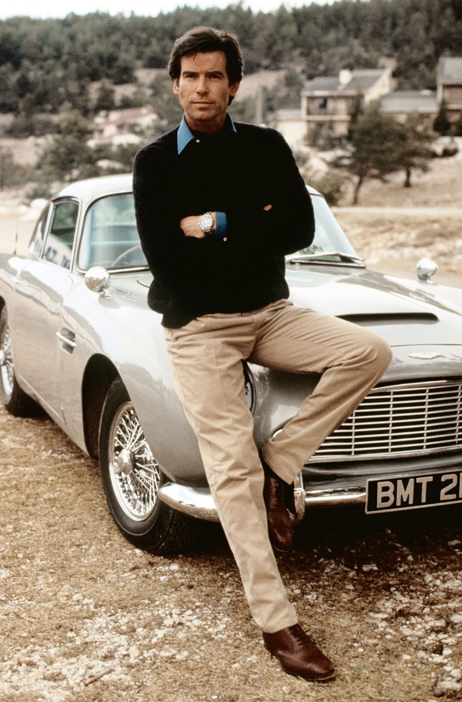 """Goldeneye (1995) – Aston Martin DB5 - The Driver: An Irishman! Pierce Brosnan's nervous debut gave us a very handsome, albeit quite stiff, Bond. His stunts (hijacking a free-falling plane to safety) were excellent, though.The Car: One of the best uses of the DB5 in the whole series: racing a Famke Janssen-driven Ferrari F355 down 2-lane Italian switchbacks. Chalk the ability of a 1964 Aston to stay abreast of a 1995 Ferrari up to movie magic; in reality, they aren't even close.The Evolutionary Leap: The franchise's achievement of balance: young star, old car, and just enough old chestnuts (""""Let's make the investigation quite thorough,"""" from Bond to his psychologist) to keep fans happy."""
