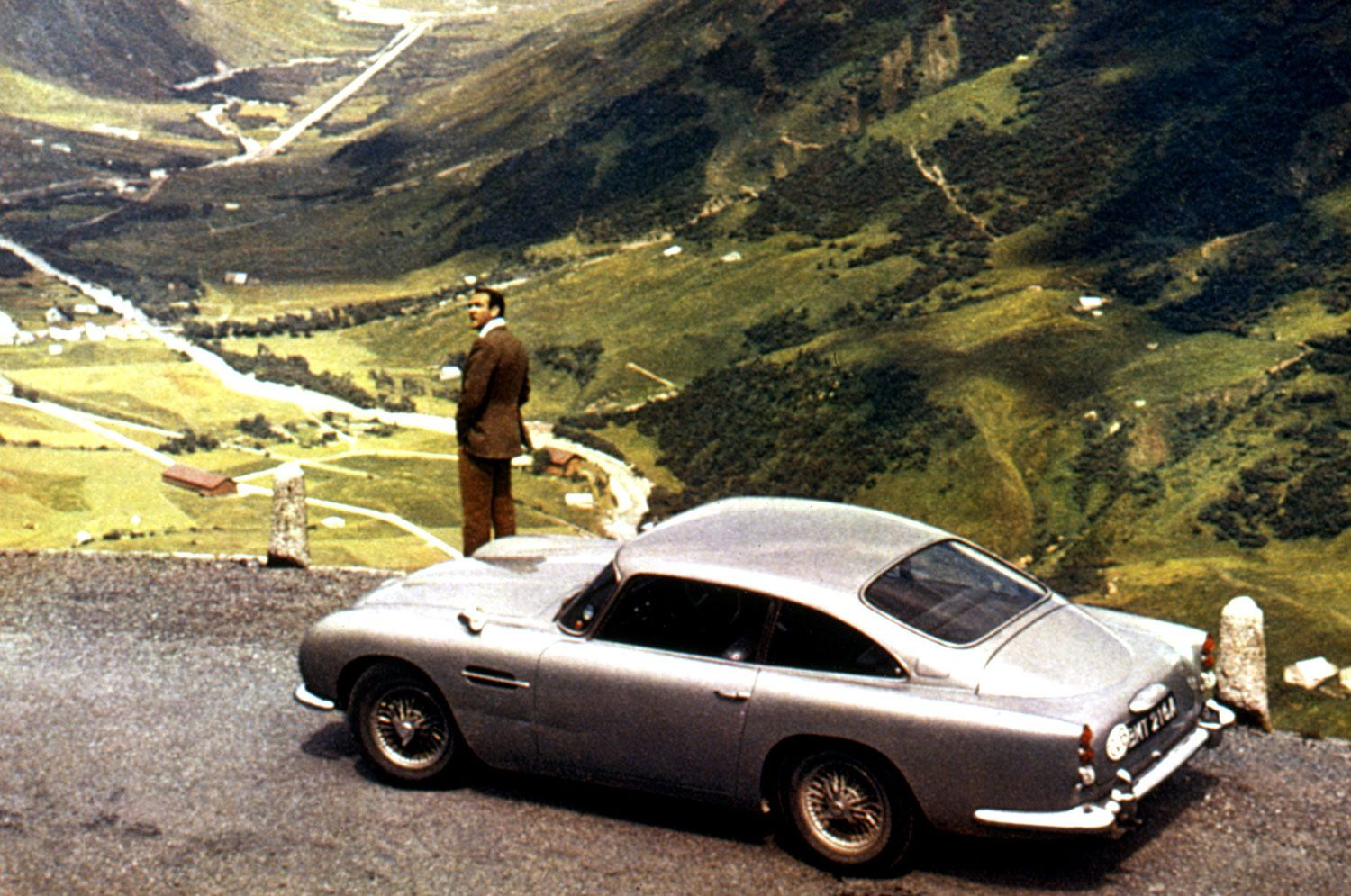 Goldfinger (1964) - Aston Martin DB5 - The Driver: Connery originated the role with charm and Savile Row swagger and, to many, has never been surpassed.The Car: In silver-birch, the DB5 debuted with as much British style as Bond himself, plus some guns in the grill. Similarly unsurpassed.The Evolutionary Leap: Bond's first Aston, and the franchise's first icon.