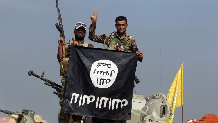 Iraqi fighters ISIS flag Getty