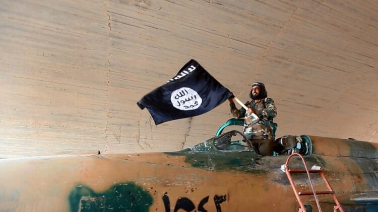 Isis fighter flag Getty