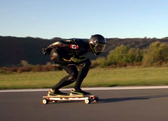 Mischo Erban zooms along at 60 MPH on an electric skateboard
