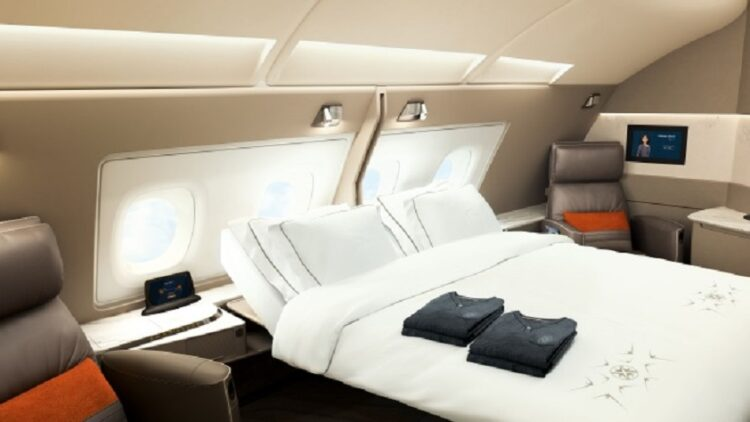 Queen bed. ON A PLANE