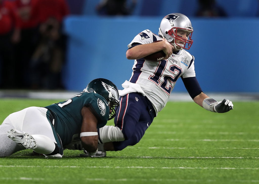 Tom Brady tackled