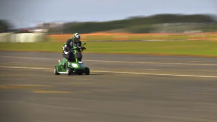 Mathew Hine rides the record-setting scooter to glory