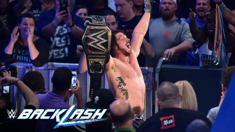 AJ-Styles-raises-his-hands-high-as-the-new-WWE-World-Champion-Backlash-2016.jpeg