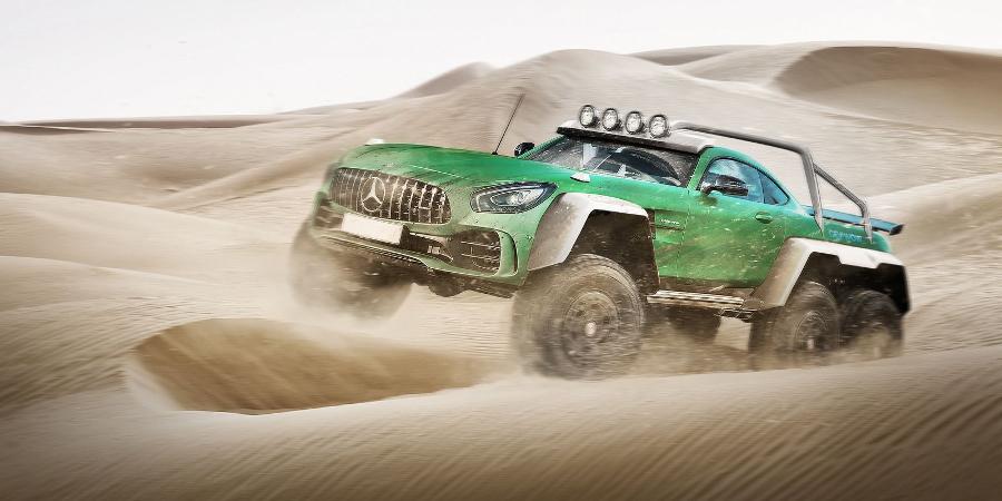 Blasting through the dunes, presumably outside Dubai (Photo: Carwow)