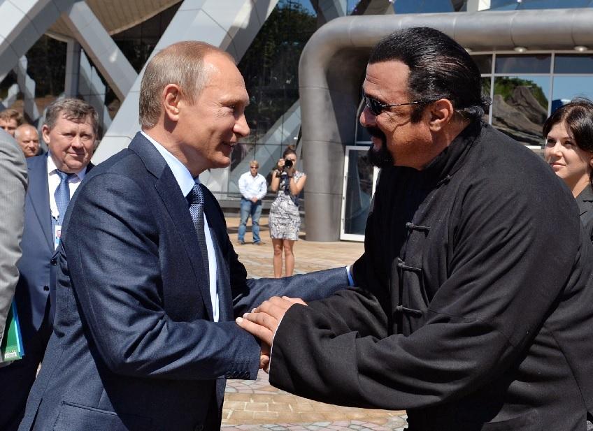 Vladimir Putin and Steven Seagal AP